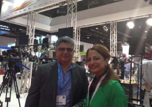Kaveh Farnam, CEO of Advanced Media Trading at CABSAT along with a team member.