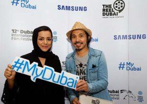 Nayla Al Khaja with the Reel Dubai competition winner Kamil Roxas.