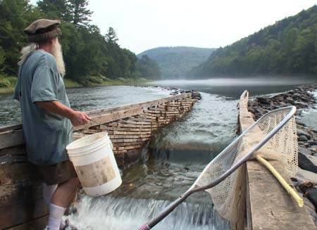 Hancock, NY: Ray admires the river from inside his weir. (Photo Credit: National Geographic Channels/ Ben Trueheart)