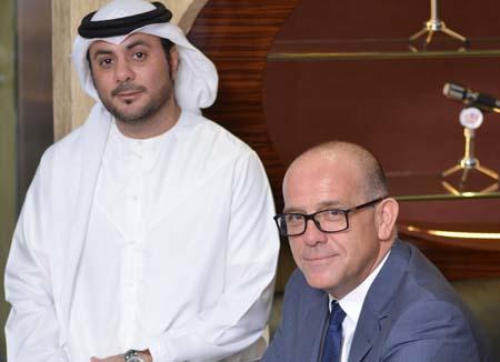 Mahmoud Al Rasheed (l) and Steve Smith.